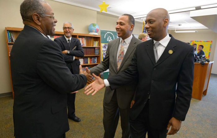 Superintendent of Orleans Parish Public Schools Henderson Lewis, Jr., Ph.D. and Superintendent Louisiana Recovery School District Superintendent Patrick Dobard, center, shake hands with Orleans Parish School Board member John Brown, Sr., left, after a press conference at Andrew Wilson Charter School announcing the return of Orleans Parish schools to local control and the forming of a Unification Advisory Committee in New Orleans, LA on Thursday, May 12, 2016 following the passage of Louisiana Senate Bill 432 to begin the process. OPSB member Nolan Marshall, Jr., looks on second from left.  Photo by Matthew Hinton of The Advocate.